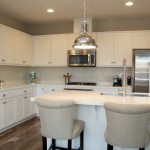 Modern kitchen - white marble counter top and stainless steel pendant lights
