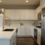 Modern kitchen - white marble counter top and stainless steel appliances